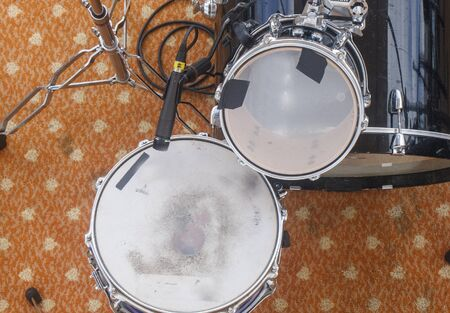 A black and white drum set from above