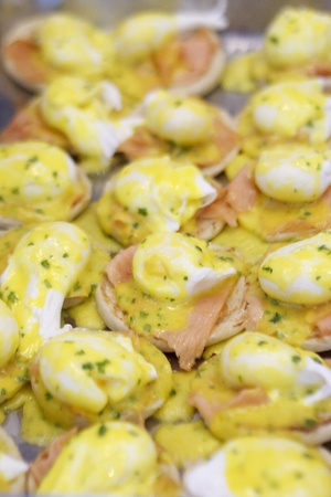 A pan of fresh cooked eggs benedict