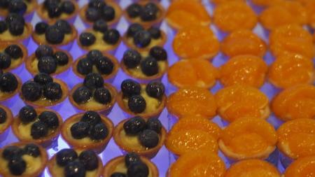 Many fruit tarts on a dessert buffet