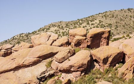Red rock boulders on a hill in the Colorado desert