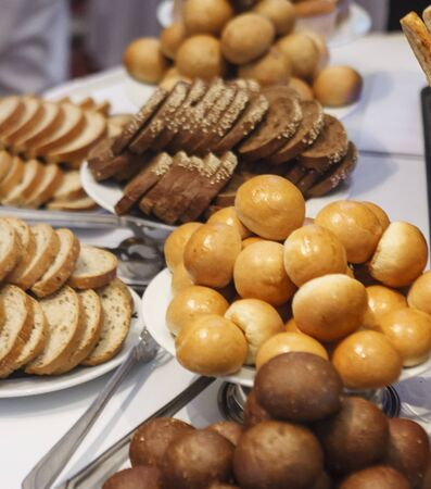 A selection of fresh bread and rolls on a buffet table