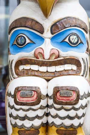 inuit: A colorful carved Inuit totem in Alaska