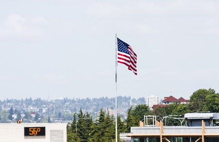 Buildings with American flag and a digital thermometer