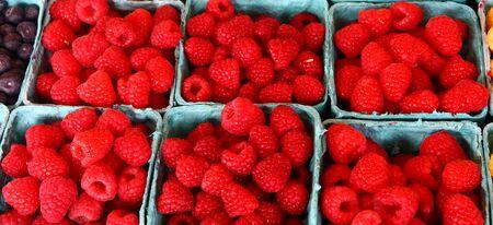 Fresh, ripe raspberries at a local farmers market
