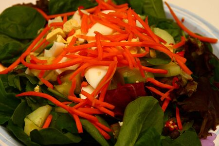 A tasty salad with spinach, eggs, carrots and other vegetables Stock fotó