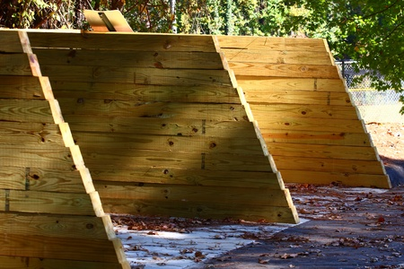 treated board: Sections of a lot partitioned with treated lumber walls