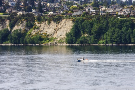 A small police boat speeding up the coast of Washington Stock Photo - 16065586