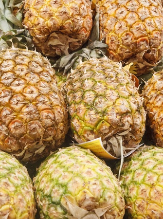 Whole, fresh, ripe pineapples for sale in a local farmers market