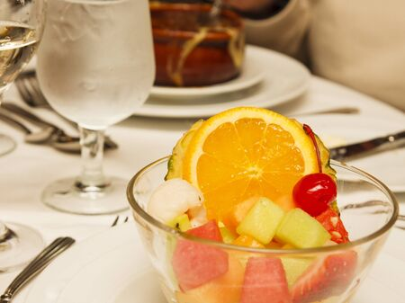 An appetizer of fresh fruit on a formal dinner table photo