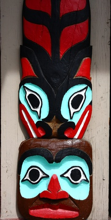 canadian pacific: A red, green and black totem carving in Alaska Stock Photo