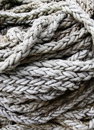 A large coil of old frayed rope Imagens