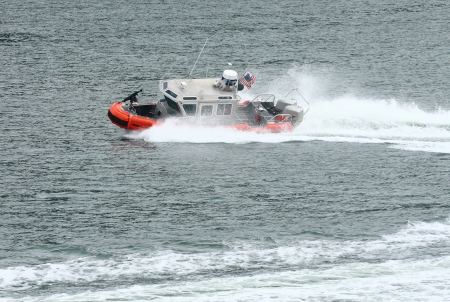 Coast Guard boat cutting through water in harbor Stock Photo - 16946676
