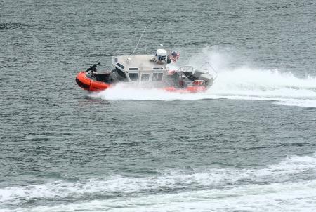 Coast Guard boat cutting through water in harbor Stock Photo - 16946676