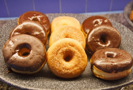 A selection of fresh donuts on a breakfast bar