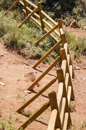 curving: A split rail fence curving across the desert