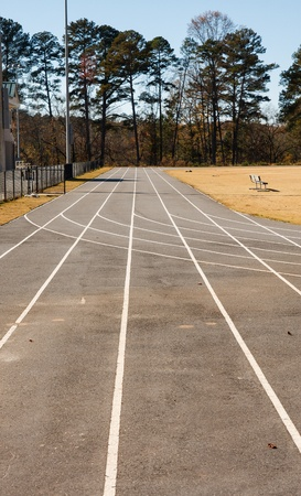 Home stretch straight away on an asphalt running track with white lanes Banco de Imagens