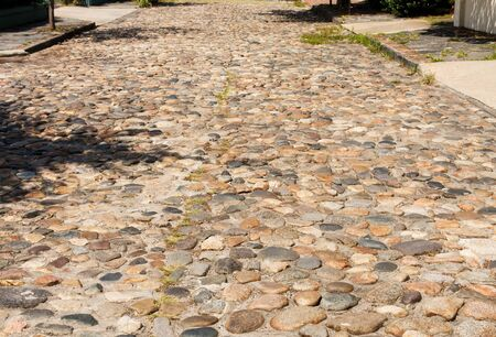 An old cobblestone road in residential Charleston, South Carolina