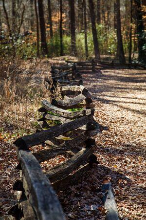 split rail: A split rail fence running through a park by a walking trail Stock Photo