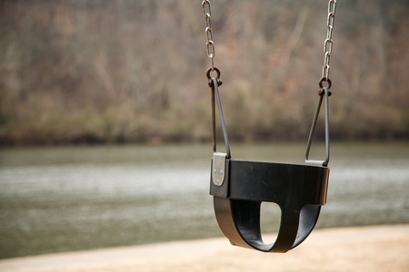 Metal and plastic swing in a playground by the river