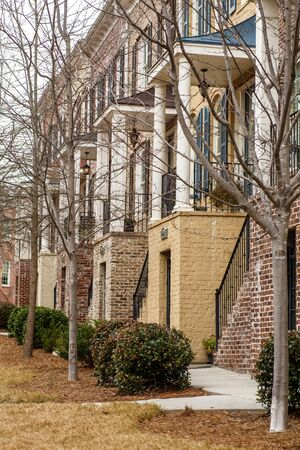 Brick columns and steps on new brick townhouses