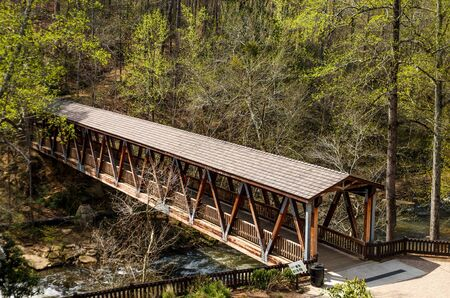 An old wooden, covered bridge in springtime forest Stok Fotoğraf