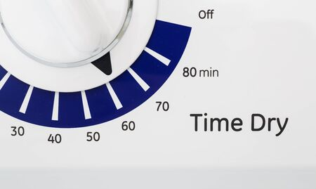 Blue and white timer on a dryer set to 60 minutes