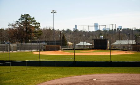 Public baseball fields with new green grass and fences Stock Photo - 19200860