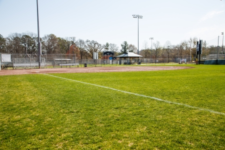 Fresh green grass in outfield of a public baseball field in the spring Stock Photo - 19200922
