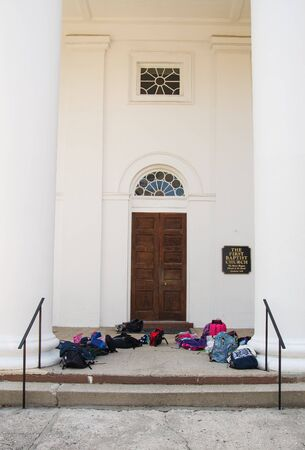 book bags: Entrance to Old Baptist Church with Childrens backpacks and book bags
