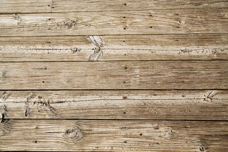 textures: Old, worn and sandy beach planks on a boardwalk