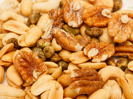 Mixed salted and roasted nuts with pistachios, peanuts, pecans and cashews Фото со стока