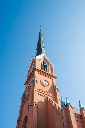 Beautiful steeple on church in Charleston, South Carolina under clear blue skies photo