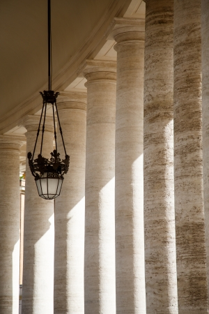 Old lamp and columns in Saint Peters Square in Vatican City