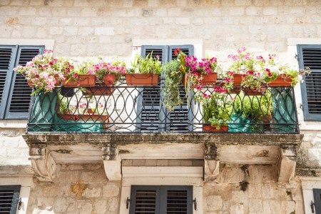 balcony: Flower boxes on balcony of an old stone building in Kotor, Montenegro