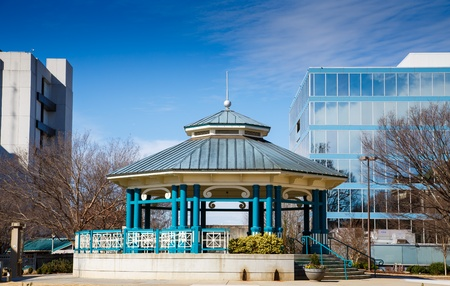 bandstand: A blue gazebo or bandstand in a small city square