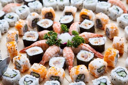 A tray of fresh sushi, shrimp and california rolls 版權商用圖片