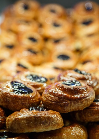 Fresh Danish pastries with prune filling in a bakery case