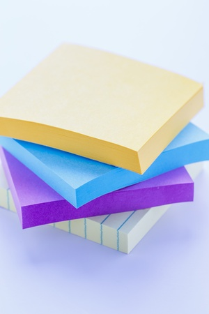 Stack of colorful sticky note pads on white