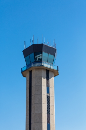 Control tower at a small regional airport against a clear blue sky photo