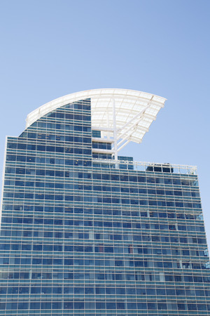 retractable: Curved White Retractable Roof on Blue Office Tower Stock Photo