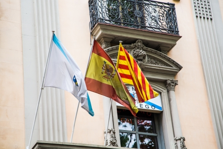 Flags of Barcelona, Spain and Catalonia on an old building on La Rambla