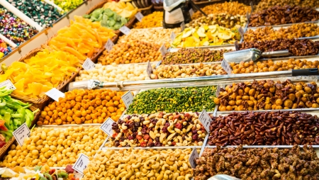 A variety of dried nuts, berries and fruit at a market photo