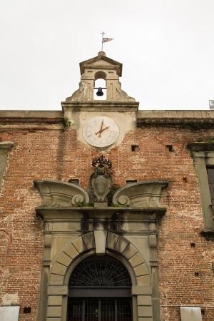 Old Clock in Pisa in Tuscany region of Italy photo