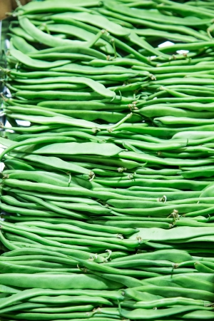 long bean: A background of fresh, green beans in a vegetable market Stock Photo