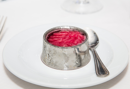 palate: An ice cold, silver ramekin filled with raspberry sorbet served between courses as a palate cleanser