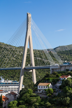Gruz Bridge in Dubrovnik, Croatia over a luxury Cruise Ship in the Harbor photo