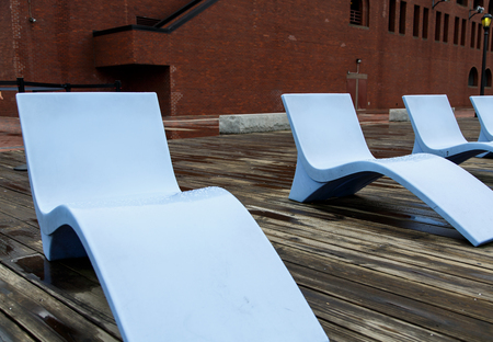 lounge: Modern Blue Chaise Lounge Chairs on a Wood Pier