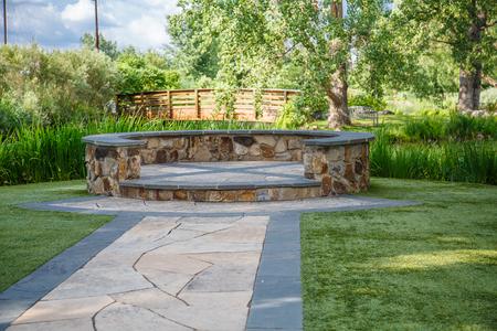 dais: A stone dais in a public garden along a stone paved path