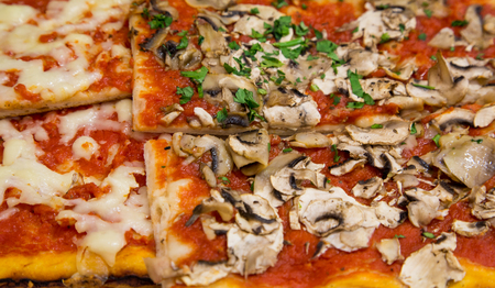 Slices of mushroom and margherita pizza in a Roman cafe