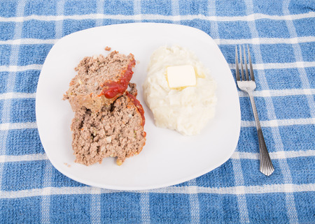 Slices of home made meatloaf with mashed potatoes with a pat of butter Stock Photo - 25514725